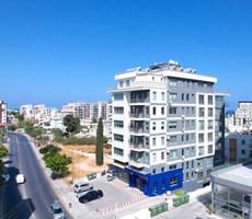 Girne Cadde üzerinde satılık Deniz manzaralı türk tapulu daire